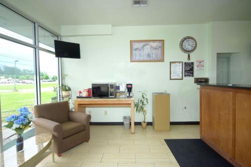 The lobby or reception area at The Shades Motel