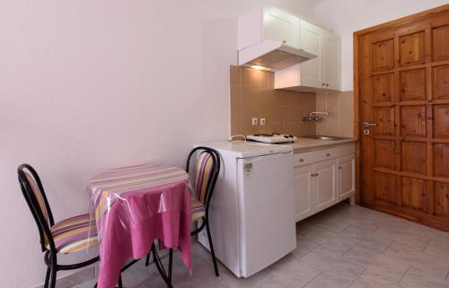 A kitchen or kitchenette at Oasis 2