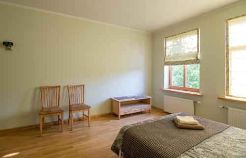 Ein Bett oder Betten in einem Zimmer der Unterkunft Helmi Hotel