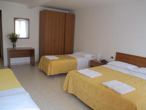 Cama ou camas em um quarto em Antica Raffineria