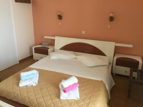 Ένα ή περισσότερα κρεβάτια σε δωμάτιο στο Hotel Methanion