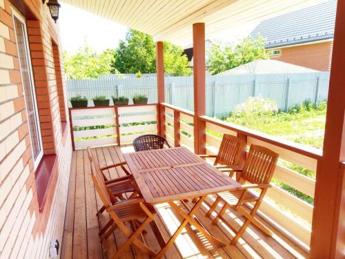 A balcony or terrace at Zvenigorod cottage Suponevo