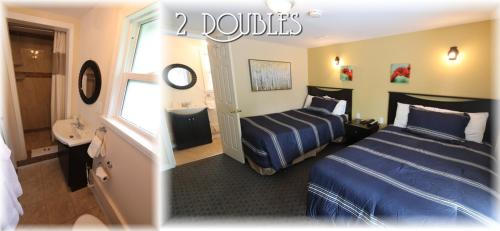 A bed or beds in a room at Twin Peaks Motel