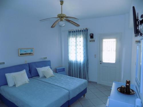 A bed or beds in a room at Margarita Karidi