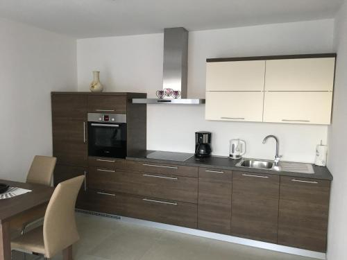 A kitchen or kitchenette at Apartments and Rooms Oražem Zoro