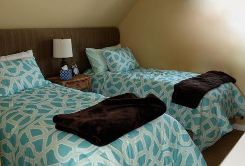 A bed or beds in a room at Collins Inn & Seaside Cottages