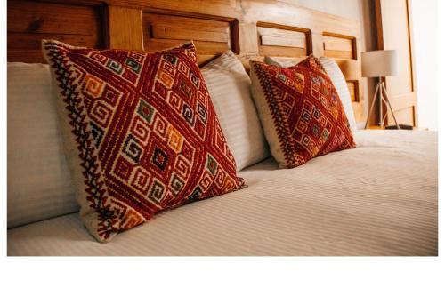 Un ou plusieurs lits dans un hébergement de l'établissement Hotel Diego de Mazariegos