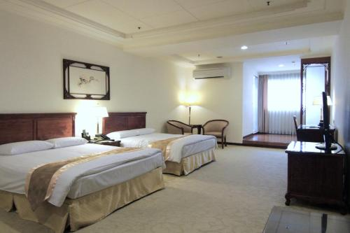 景園大飯店房間的床