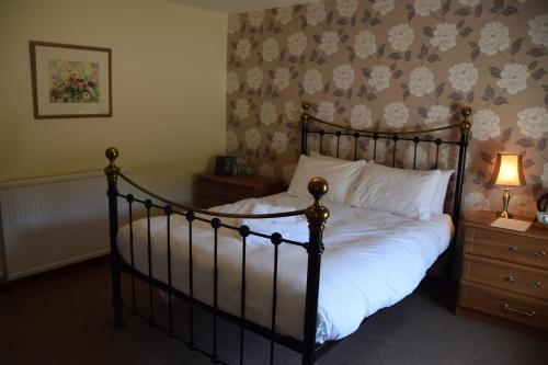 A bed or beds in a room at Saplinbrae Hotel and Lodges