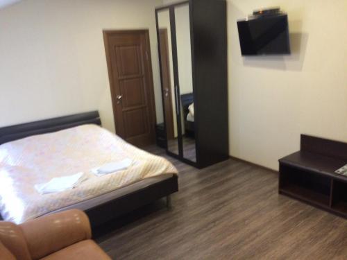Кровать или кровати в номере Отель Привал