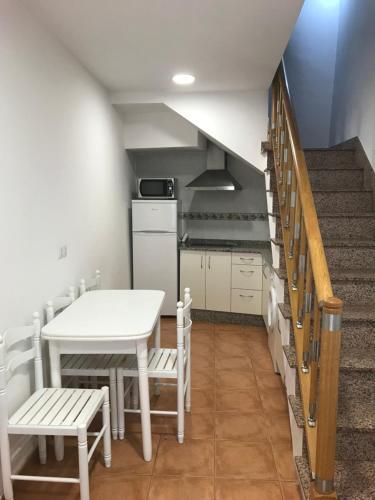 Una cocina o zona de cocina en Apartamentos San Guillermo