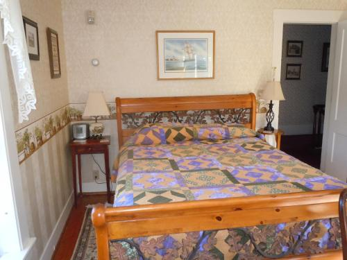 A bed or beds in a room at Fitch Hill Inn