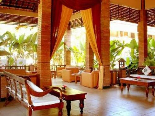A restaurant or other place to eat at Nyiur Resort Hotel