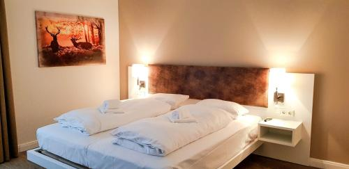 A bed or beds in a room at Ferienquartier Winterberg
