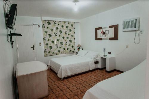 Cama ou camas em um quarto em Pousada Pontal da Praia