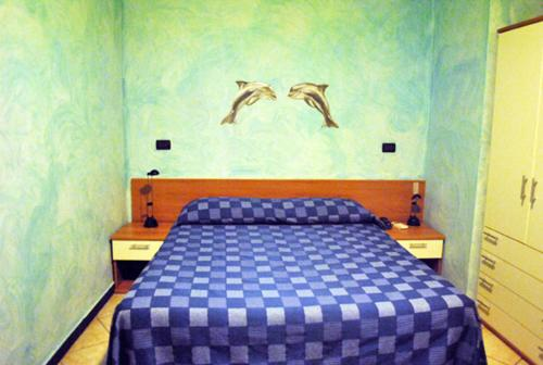 A bed or beds in a room at Hotel Acquario