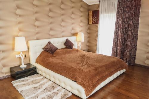 Кровать или кровати в номере Апартаменты Гранд Стадион
