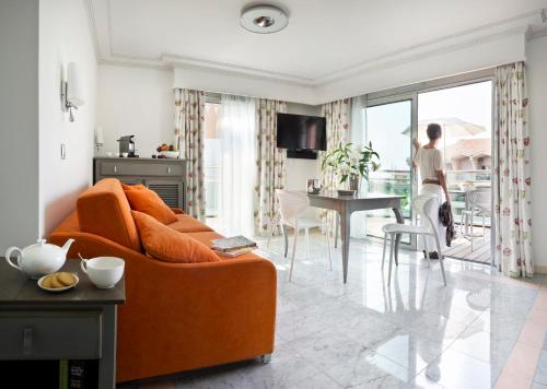 Coin salon dans l'établissement CGH Résidences & Spas Villa Romana