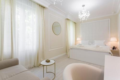 A bed or beds in a room at Boutique Hotel Bačvice