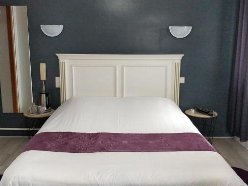 Un ou plusieurs lits dans un hébergement de l'établissement Les Grands Voyageurs