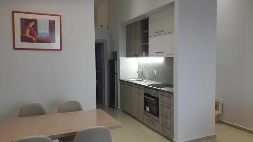 A kitchen or kitchenette at Casa Bella Deluxe Apartments