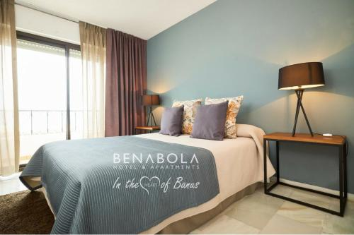 A bed or beds in a room at Benabola Hotel & Suites