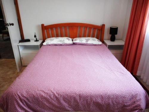 A bed or beds in a room at Norfolk at Hat Head