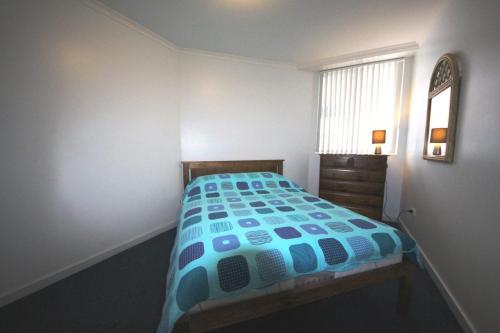 A bed or beds in a room at The Avenues Unit 1 at South West Rocks