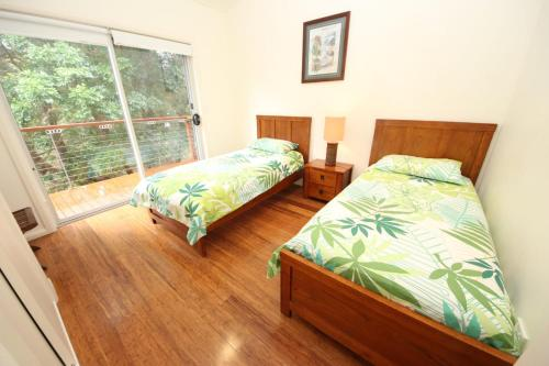 A bed or beds in a room at Trial Bay Eco Lodge 2 Pandanus