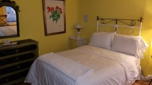 A bed or beds in a room at Incentra Village Hotel
