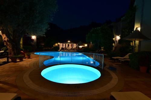 The swimming pool at or near Olive Garden Apart Hotel