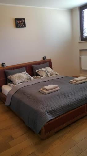 A bed or beds in a room at City Centre Apartments