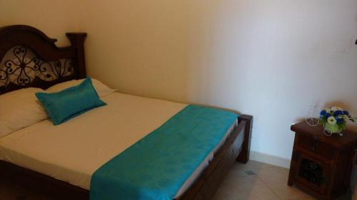 A bed or beds in a room at Hotel Campestre Llano Caribeño