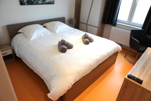 A bed or beds in a room at Elberg ApartHotel