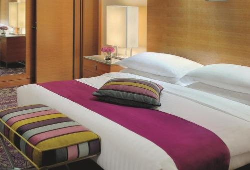A bed or beds in a room at Mövenpick Hotel West Bay Doha