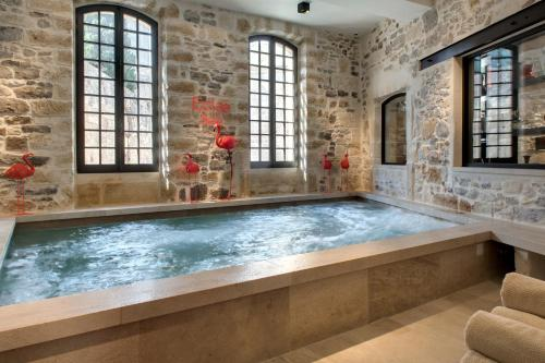 The swimming pool at or near Boutique Hôtel des Remparts & Spa