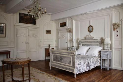 Un ou plusieurs lits dans un hébergement de l'établissement Le Clos du Prince