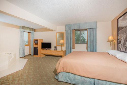 A television and/or entertainment center at Super 8 by Wyndham Monroe WI