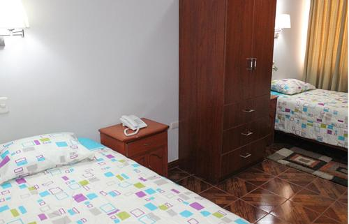 A bed or beds in a room at Hostal Residencial Lino