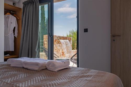 A bed or beds in a room at Agata Art Villa Sea View Private Pool Fiskardo Kefalonia