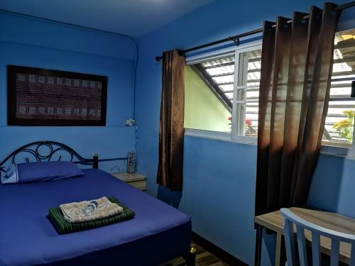Cama o camas de una habitación en PM Guesthouse