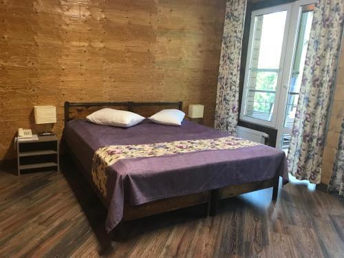 Кровать или кровати в номере Урочище Актра