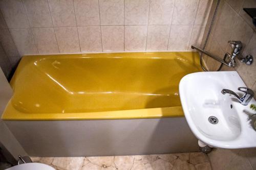 Vannas istaba naktsmītnē Z - apartment