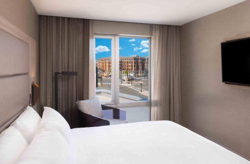 A bed or beds in a room at AC Hotel by Marriott Boston Cleveland Circle