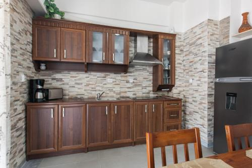 A kitchen or kitchenette at Athens cozy rooms walk to Acropolis