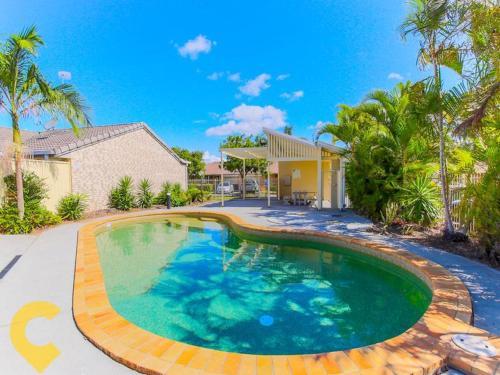The swimming pool at or near Gold Coast Theme Park Family Villa