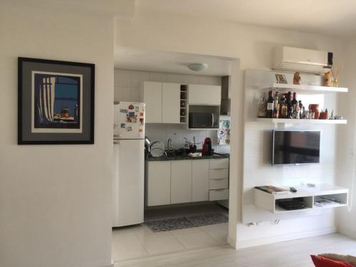 A kitchen or kitchenette at Vista Panorâmica com piscina