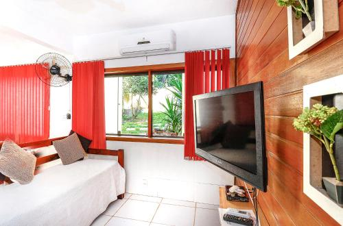 A television and/or entertainment centre at Adora Suites