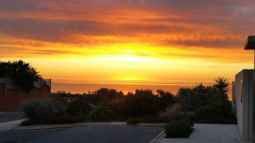 The sunrise or sunset as seen from the vacation home or nearby