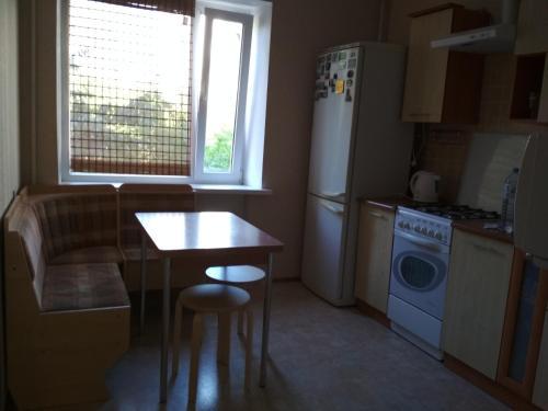 A kitchen or kitchenette at Apartments on Orbitalnaya